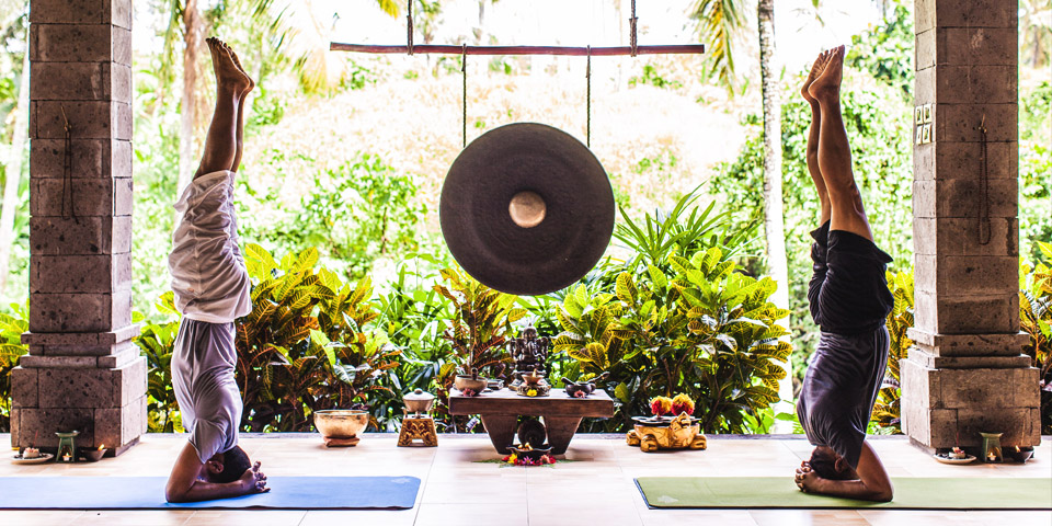 experienced Balinese yoga teachers and retreat leaders, Iyan and Wayan